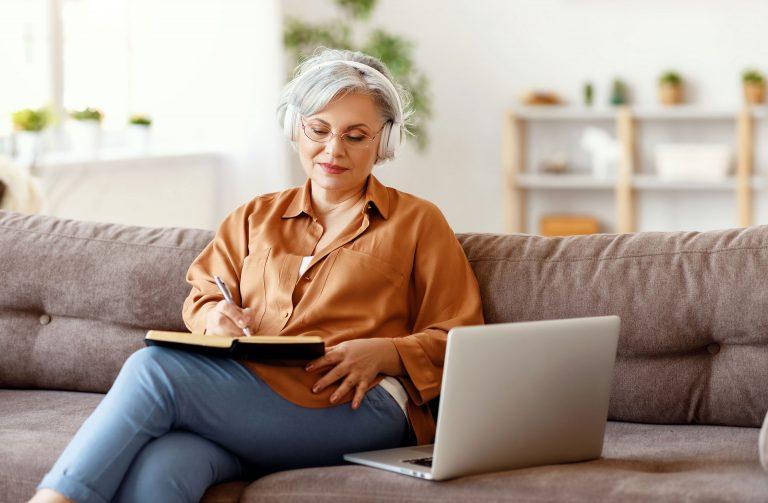 A senior doing online research on senior living providers